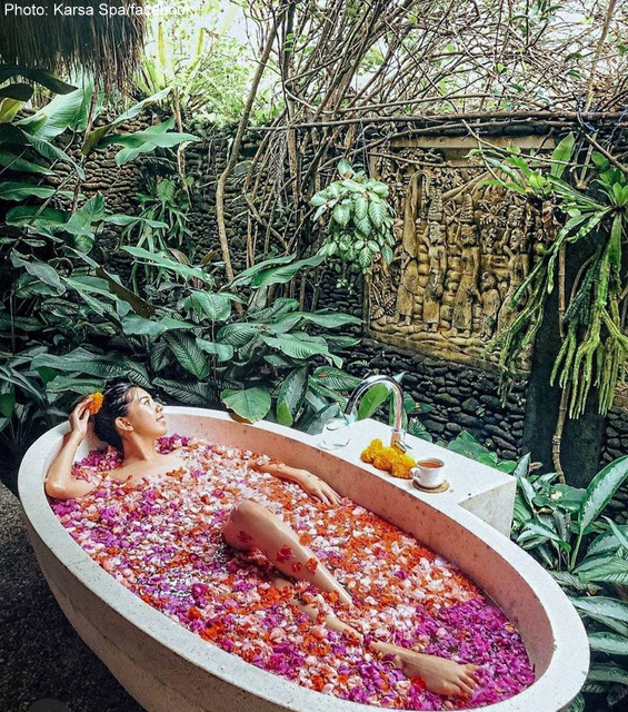 Relax in a scented warm flower bath at Karsa Spa