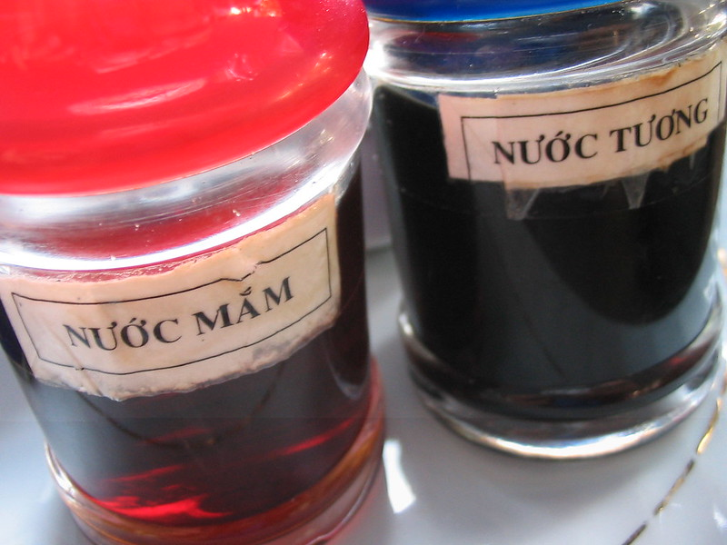 On the left is fish sauce (nước mắm) and on the right is soy sauce (nước tương).