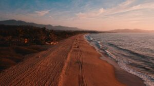 Sunset over beach Mexico - where to stay in Qaxaca