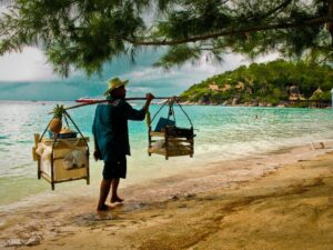 Trader on beach in Thailand