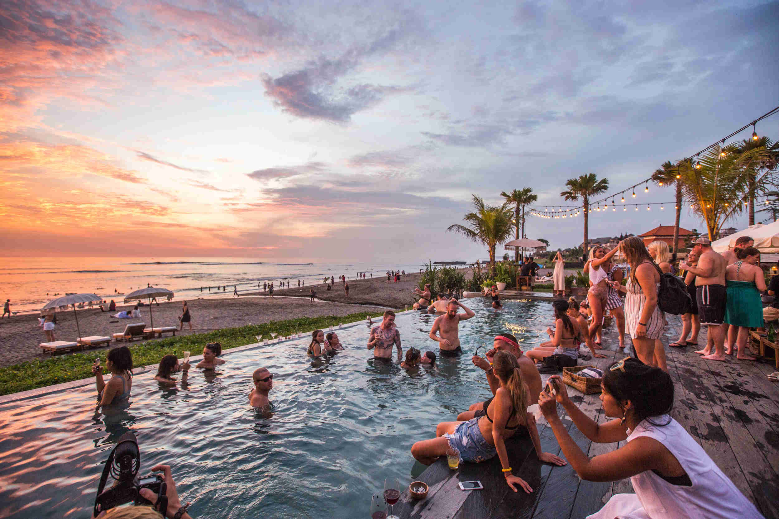 Group of guests at beach party in Canggu, Bali
