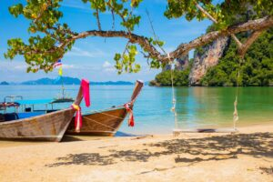 Longtail boats on beach in Thailand