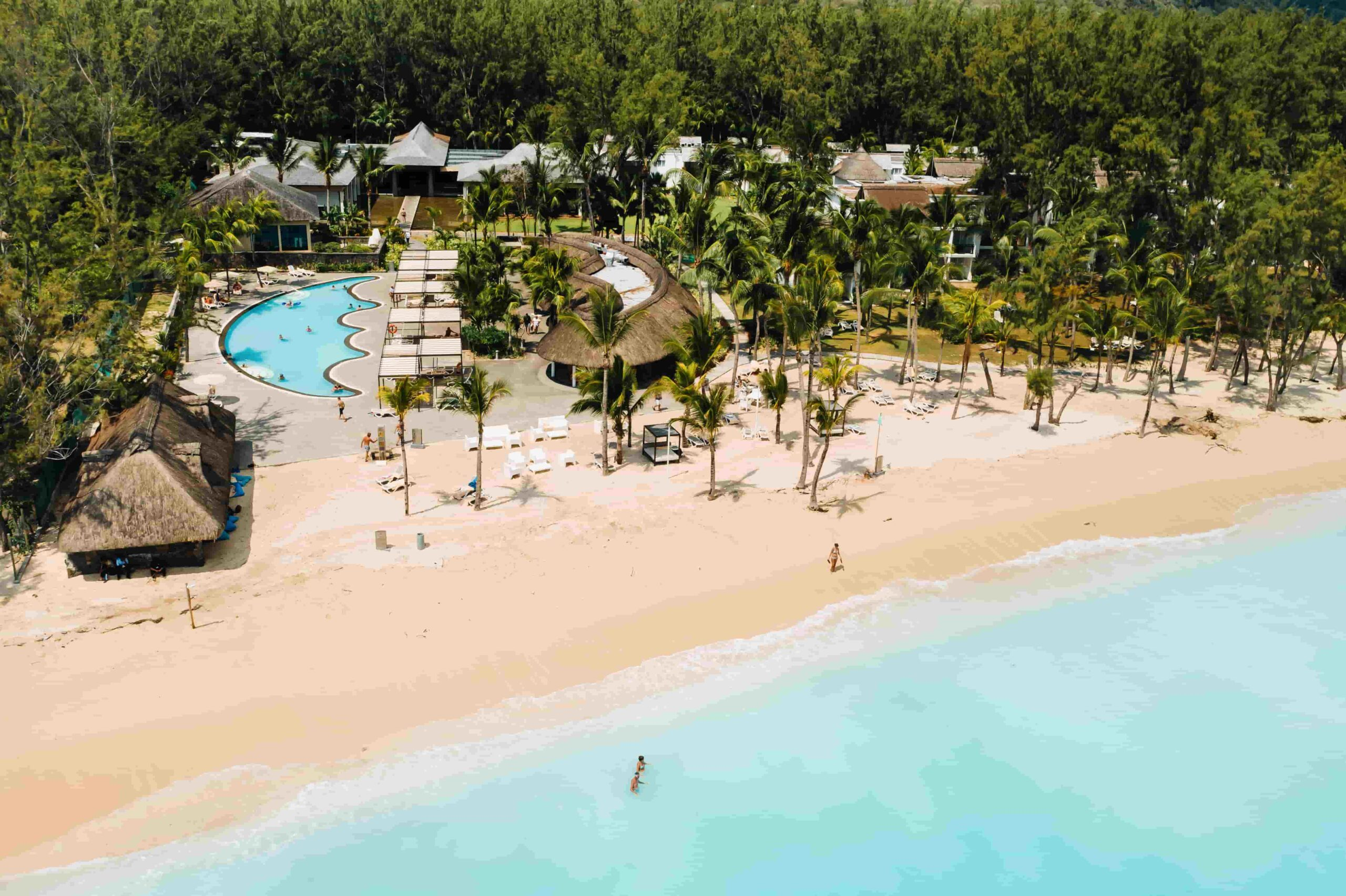 Pool and beach at luxury resort in Mauritius