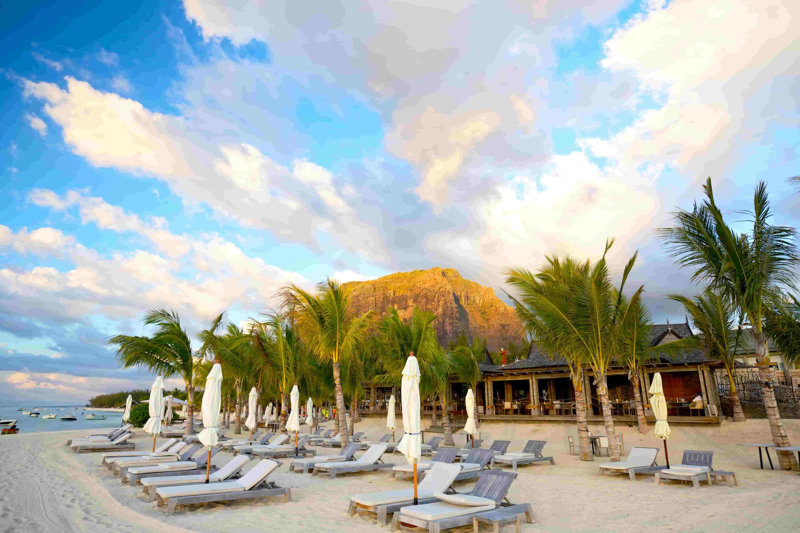 Sun loungers and umbrellas on beach in Mauritius