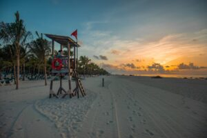 Life guard on beach at sunset