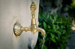 Gold metal tap with running water