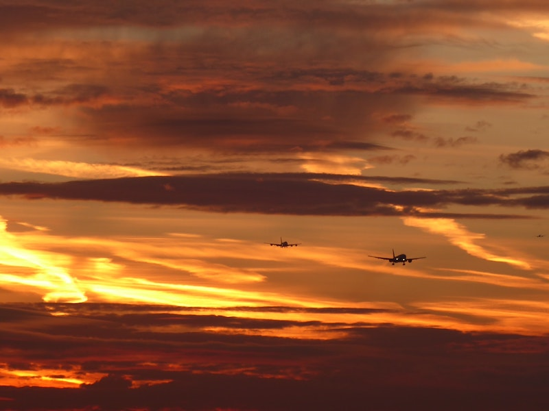 planes flying over sunset