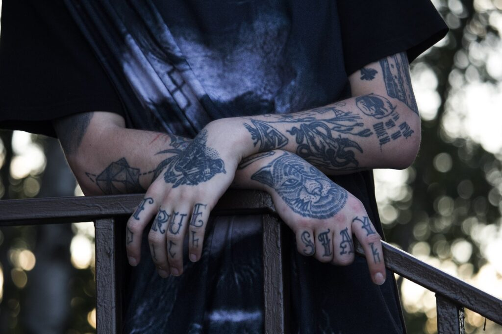 Tattooed arms and hands