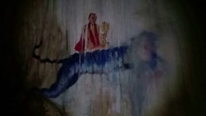 Ancient Buddhist cave art inside Naka Cave | Photo Credit: Maggie's Journey